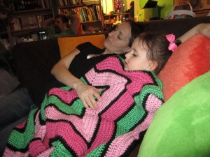 Hailey and her mom cuddle up under the starry blanket